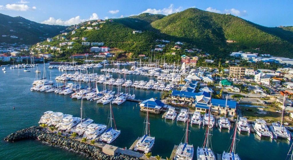 showing an aerial photo of the BVI Moorings where I assisted in managing a multi million pound rejuvenation project to repair the boats after the hurricane.