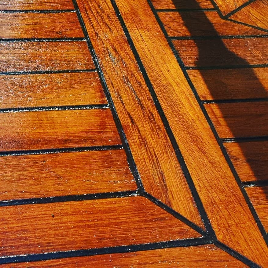 Trader 40 teak deck in flybridge after renovation, breathing life and colour back into this amazing deck.